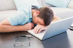 Man sleeping on a table Stock Images