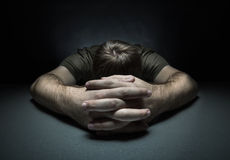 Man sleeping on the table Stock Photography