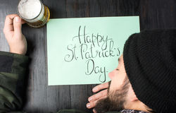 Man sleeping on a table on St Patricks day Royalty Free Stock Photos