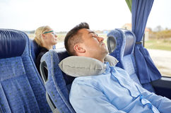 Man sleeping in travel bus with cervical pillow Royalty Free Stock Images
