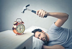 Man sleeping and using a hammer Royalty Free Stock Photos