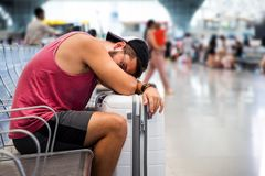 Man sleeping while waiting on the train station stock image