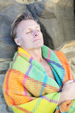 Man sleeping wrapped in blanket. Color portrait photo of a  mature man sleeping wrapped in blanket Stock Photography