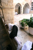 A man sleeping in the yard at Mount Zion, Jerusalem Royalty Free Stock Photo