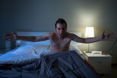 Man sleepless in his bed screaming after nightmare Royalty Free Stock Images