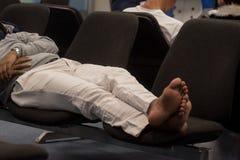 Man sleeps at airport Royalty Free Stock Image