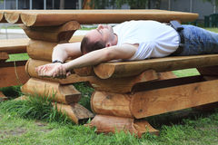 Man sleeps on bench. Stock Photography