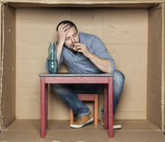 Man sleeps and drinks alcohol Stock Images