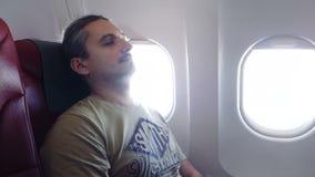 Man sleeps In Plane stock footage