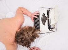 Man sleepy lay bedclothes while work. Writer used old fashioned typewriter. Exhausting occupation. Author tousled hair. Fall asleep while write book. Workaholic stock photos