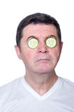 Man with slice cucumber over eyes Royalty Free Stock Photos