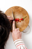 Man slicing Chilli pepper Royalty Free Stock Images