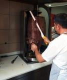 Man slicing doner kebab royalty free stock photos