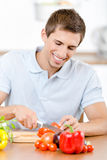 Man slicing groceries for breakfast Stock Photos