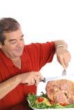 Man slicing a ham vertical Stock Images