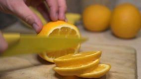 Man Slicing An Orange stock video