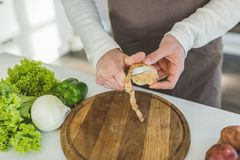 Man slicing potato Royalty Free Stock Images