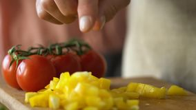 Man slicing vegetables, preparing dinner with wife, vegetarian family traditions. Stock footage stock video footage
