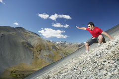 Man Sliding Down Scree Field Royalty Free Stock Photo