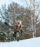 Man sliding on sleds downhill Royalty Free Stock Photo