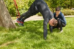 Man sling training with Personal Trainer royalty free stock photography