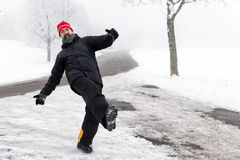 Man is slipping on a icy road Royalty Free Stock Photo