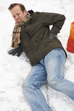 Man Slipping Over In Snowy Street Stock Photos