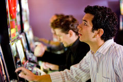 Man at the slot machines Stock Photography