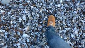 Man slow walking on a gravel stock video