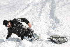 Man slumping in the deep snow after a sleigh ride with a sledge Royalty Free Stock Photography