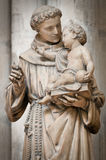 Man with small boy statue. Stock Image