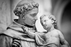 Man with small boy statue. Stock Photos
