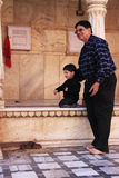 Man with a small boy watching rats at Karni Mata Temple, Deshnok Royalty Free Stock Photos