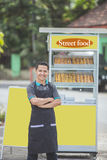 Man with small business food stall Stock Photo