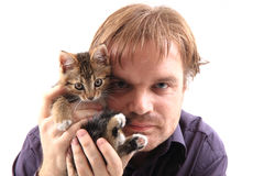 Man and small cat Stock Image