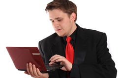 Man with small computer laptop Stock Image