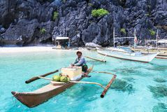 A man on small paraw at the sea of El Nido, Philippines. This photo was taken in Palawan island. El Nido Palawan Philippines has some of the most beautiful Royalty Free Stock Photo