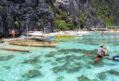 A man on small paraw at the sea of El Nido, Philippines. This photo was taken in Palawan island. El Nido Palawan Philippines has some of the most beautiful Stock Images