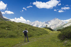 Man on a small path Stock Images
