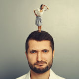 Man with small serious woman. Displeased men with small serious woman Royalty Free Stock Photo