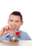 Man with a small shopping basket. Stock Photography