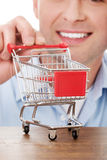 Man with a small shopping basket. Stock Images