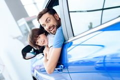 A man with a small son is sitting at the wheel of the car. Royalty Free Stock Photography