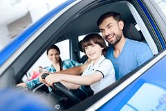 A man with a small son is sitting at the wheel of the car. Stock Photography