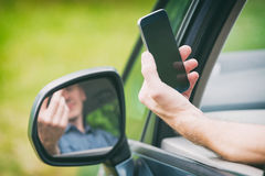 Man with smart phone in the car Royalty Free Stock Photo