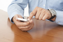 Man with smart phone on hand Royalty Free Stock Photo