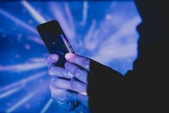 man with smart phone in hands on colorful background royalty free stock photography