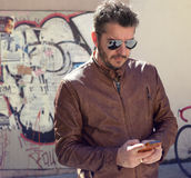 Man with smart phone Royalty Free Stock Images