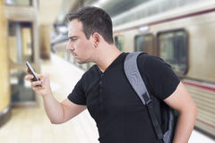 Man and a smart phone. Man using a smartphone in subway Stock Images