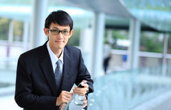 Man on smart phone - young business man. Casual urban profession Royalty Free Stock Images